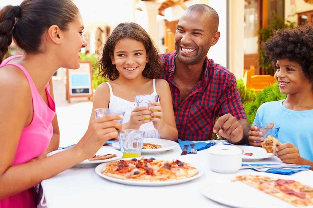 Black American family eating at restaurant and being careful with allergens