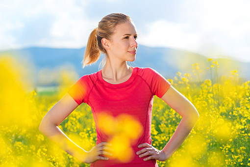 Photo of young woman in a field of goldenrod