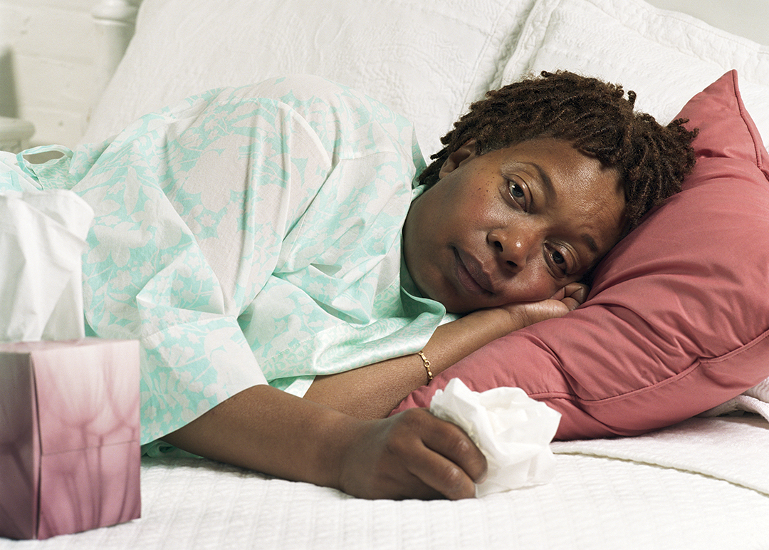 photo of Woman bed with the flu