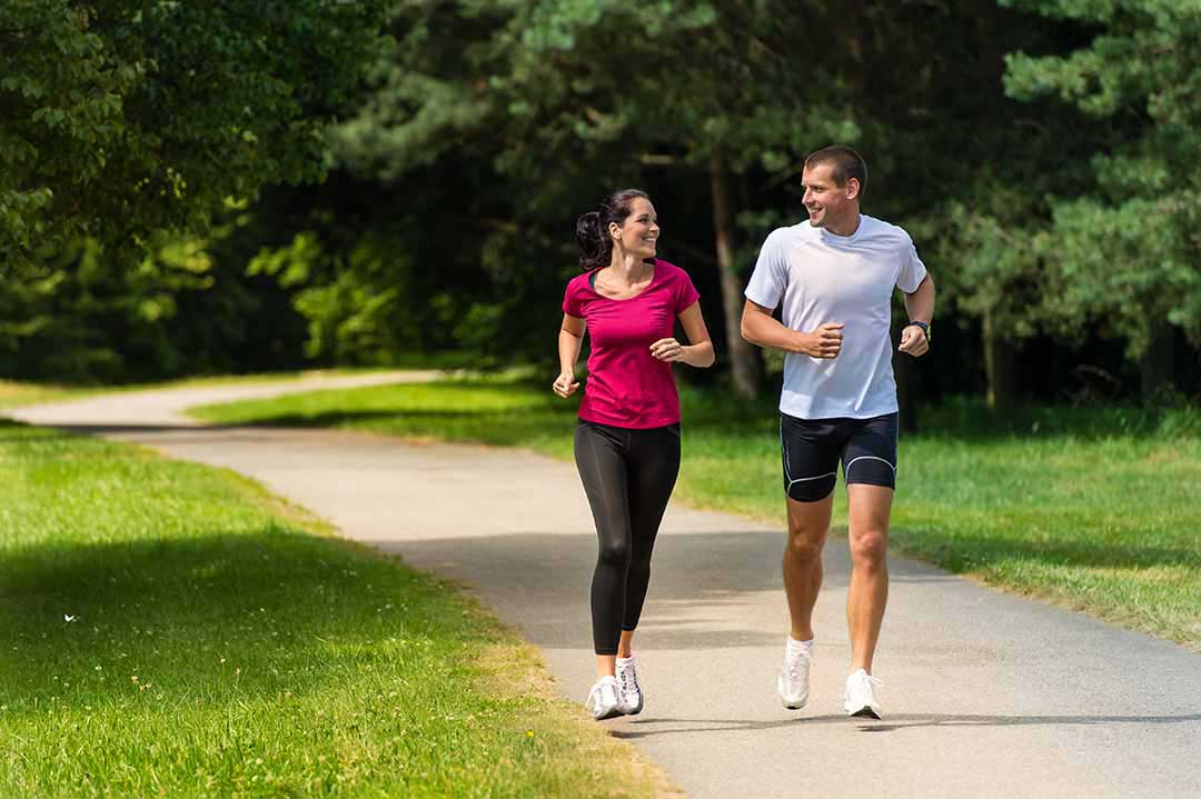 Photo of man and woman jogging in a park