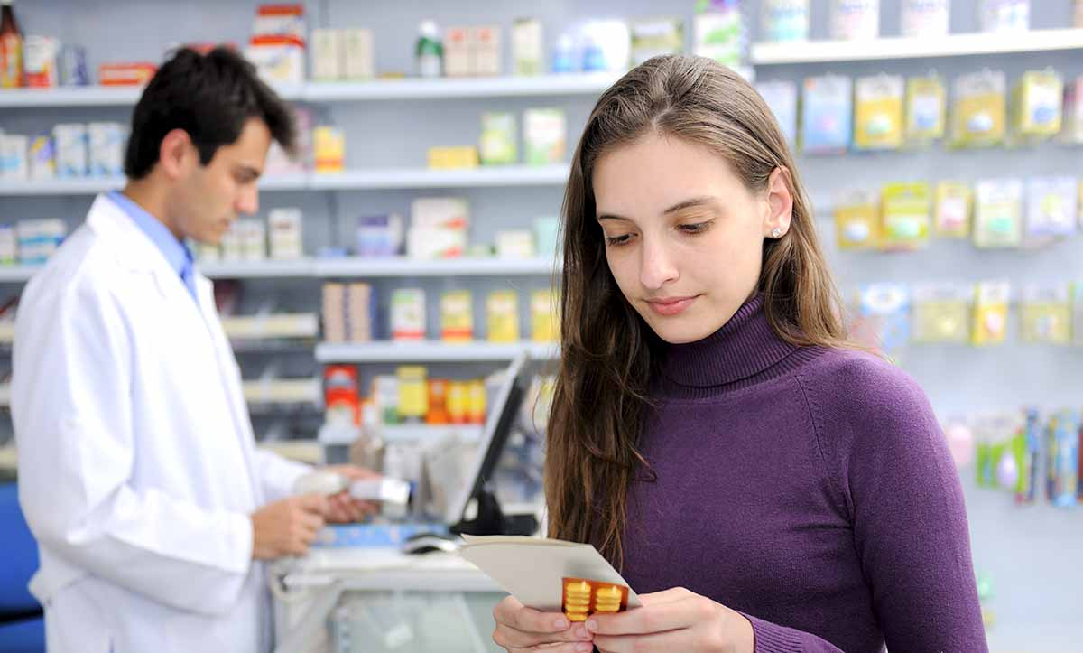 Photo of Consumer with medicine at pharmacy