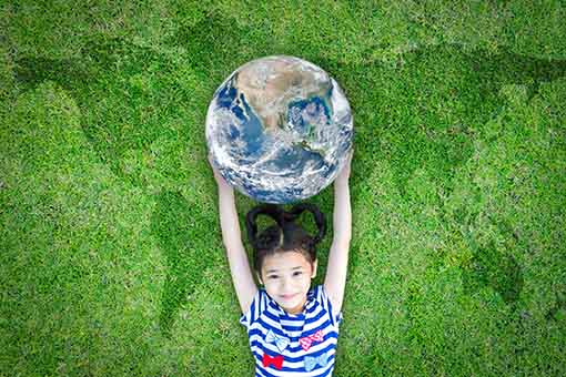 Photo of child holding the world