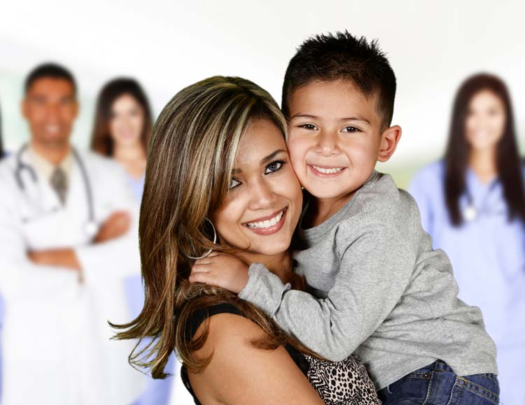 Latino mom and son at hospital with doctors and nurses in the background
