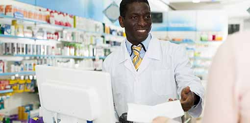 Photo of man at a pharmacy counter