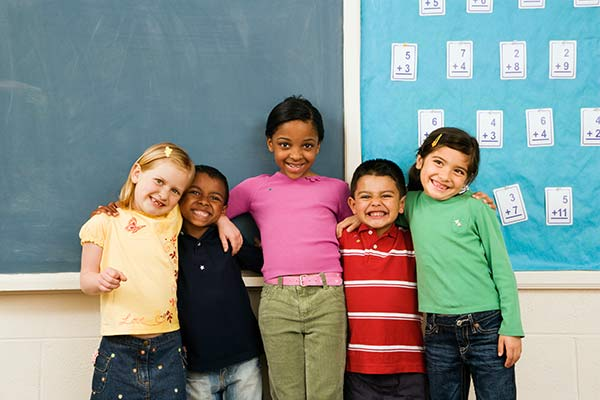 Image of various ethnic children lined up in front of the class