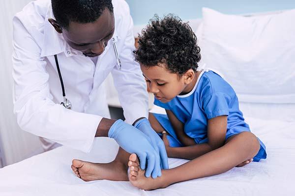 Doctor examining ethnic child